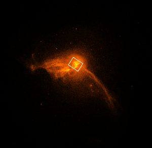 Image of luminous gas at the core of the M87 galaxy, marked with the position of the black hole and its accretion disk